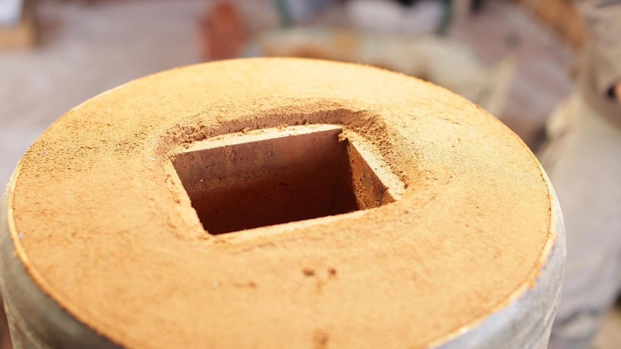 Stage d'autoconstruction d'un poêle de masse rocket-stove